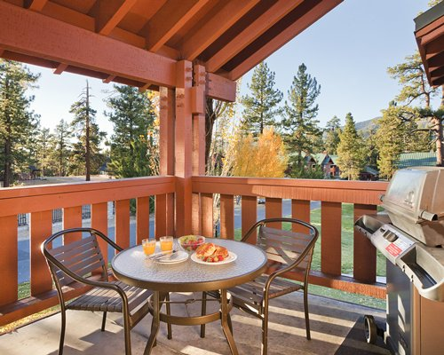 An outdoor patio with barbecue grill.