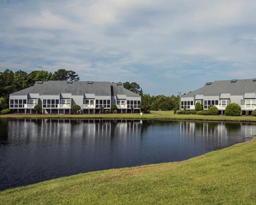 A scenic exterior view of multiple villas near the waterfront.