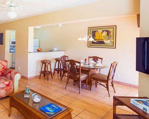 An open plan living dining and kitchen area with a breakfast bar.