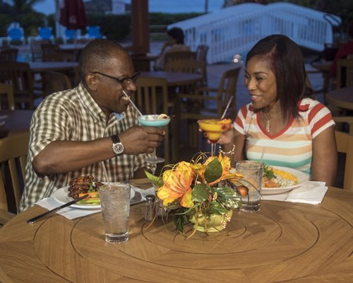 A couple in a fine dining restaurant at the Island Seas Resort.
