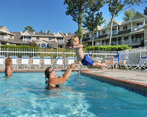 A family in the outdoor swimming pool at the resort.