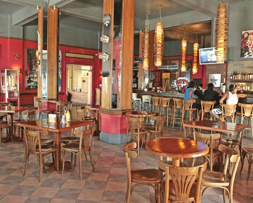An indoor restaurant with a bar.