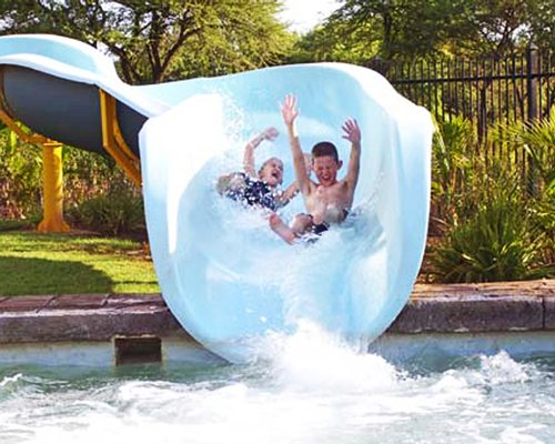 View of kids sliding in a water slider.