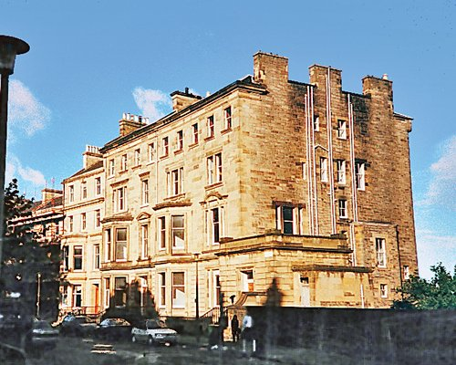 An exterior view of The Edinburgh Residence with car parking.