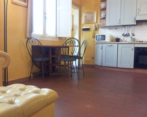 A well equipped kitchen with a dining table.