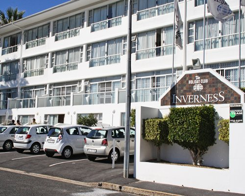 Scenic exterior view of Inverness with multiple balconies and parking lot.