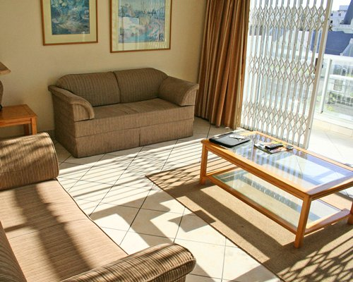 A well furnished living room with a double pull out sofa and an outside view.