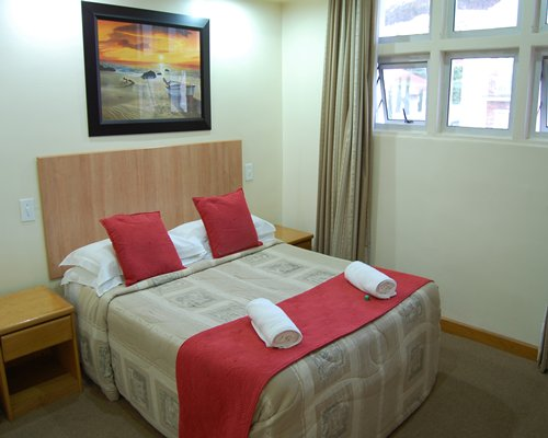 A well furnished bedroom with a single bed and outside view.