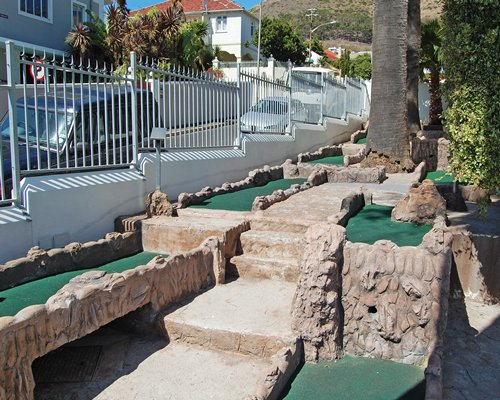 View of miniature golf courses with trees.