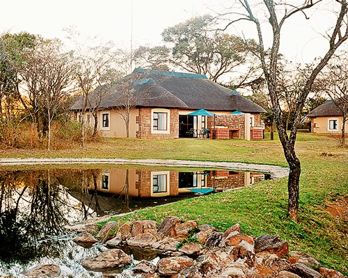 Scenic exterior view of a unit at Waterberg Game Park alongside the waterfront.
