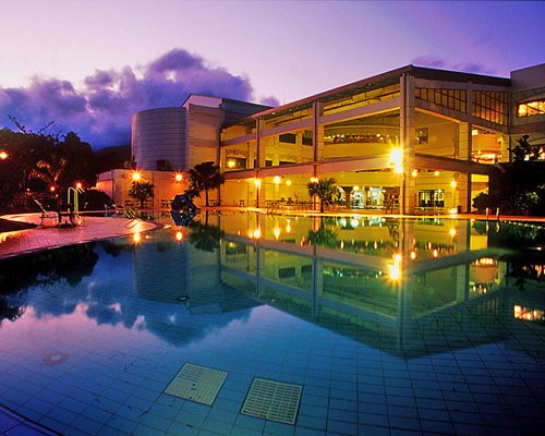 Scenic view of Kentington Resort with outdoor swimming pool at dusk.