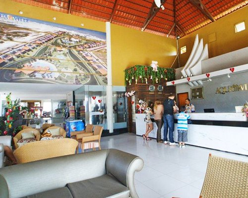 A well furnished reception area of the Aquaville Resort with lounge access.