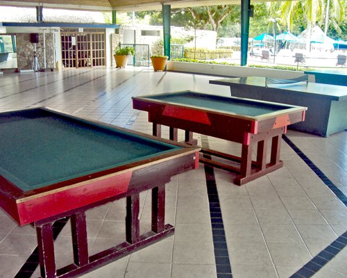 Lounge area and indoor recreation area with pool table.