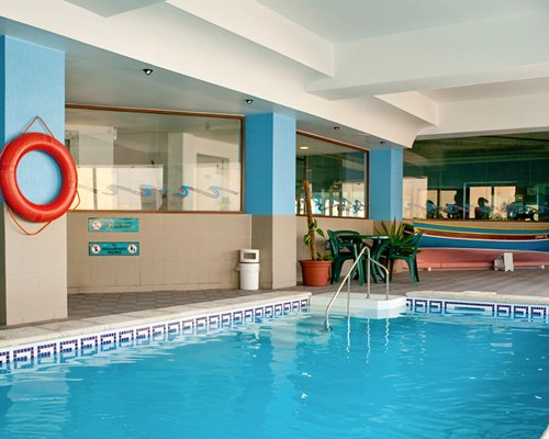 Indoor swimming pool at Porto Azzurro Resort Club.