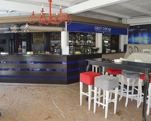 An indoor bar at the Porto Azzurro Resort Club.