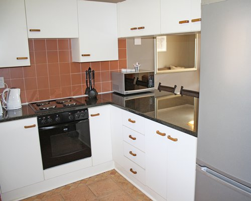 A well equipped kitchen with microwave .