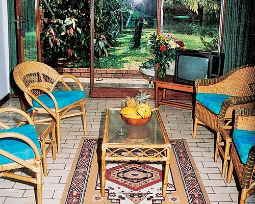 A well furnished living room with television and patio.