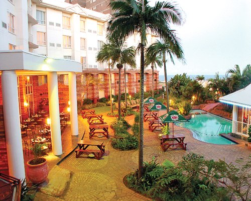Exterior view of The Riverside Hotel & Spa with an outdoor swimming pool.