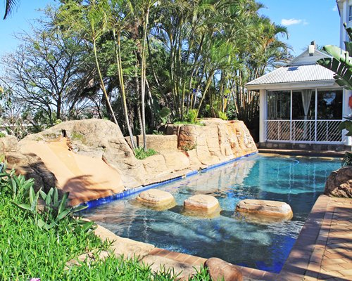Outdoor grotto pool with a picnic area.