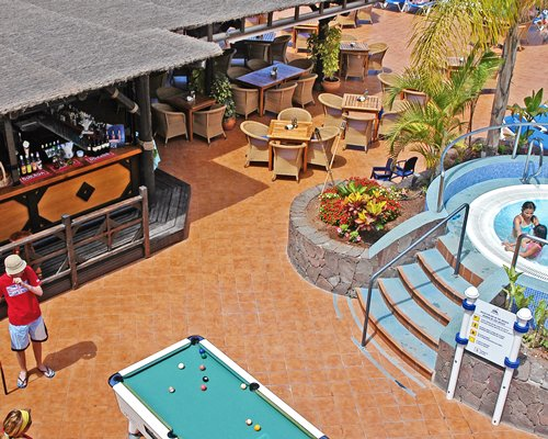 A view of an outdoor recreational area with a pool table.