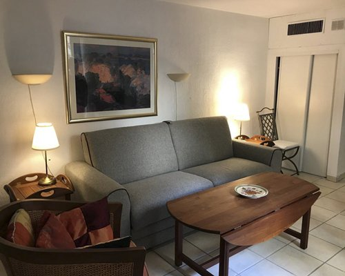 A well furnished living room with a television dining area and outside view.