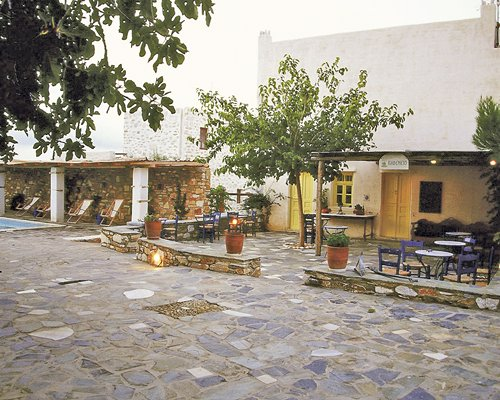 Exterior view of Anezina Village with outdoor dining area.