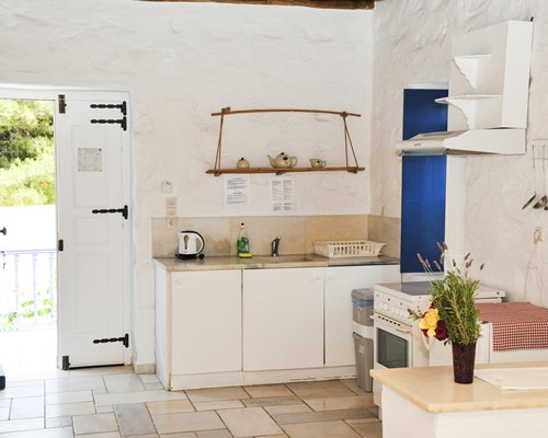 A well equipped kitchen with a patio.