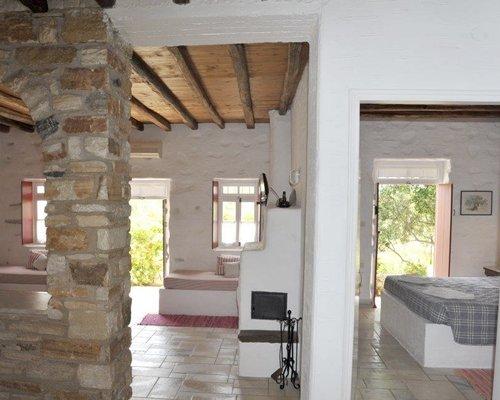 A well furnished indoor room alongside bedrooms.
