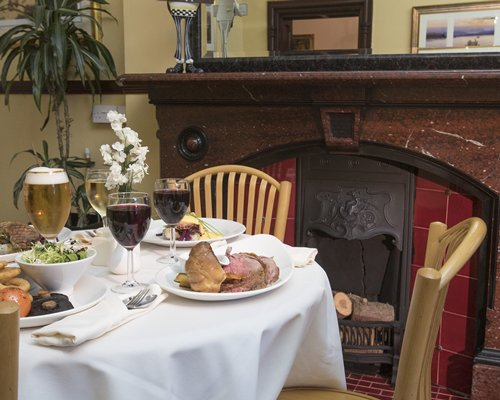 Indoor restaurant with a fireplace at Brockwood Hall.