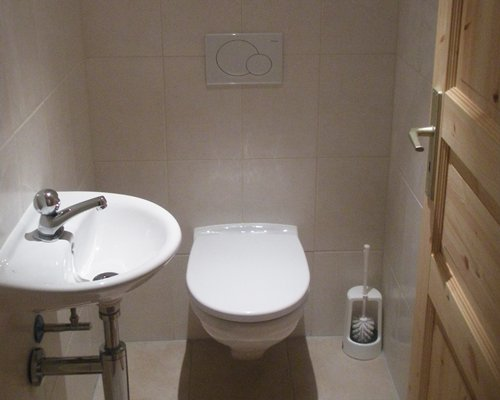 A bathroom with a toilet and sink.