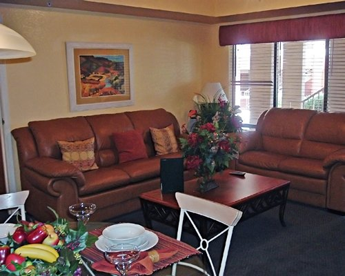 A well furnished living room with dining area.