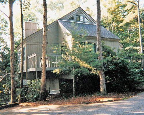 Exterior view of a unit at wooded area.