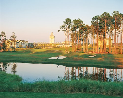 Scenic view of Resort at World Golf Village with a golf course alongside the waterfront.