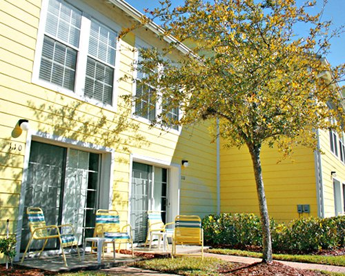 Scenic exterior view of a unit at Barefoot'n in the Keys at Old Town with patio chairs.