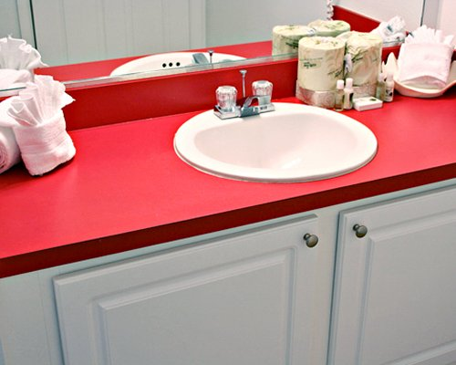 A bathroom with closed sink vanity.