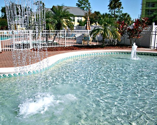 An outdoor pool with water sprinkles.