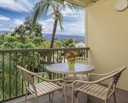 Balcony with patio furniture with the scenic landscape and the ocean.
