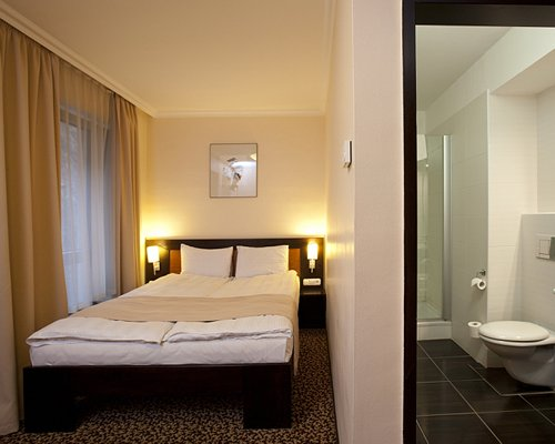 A well furnished bedroom with an attached bathroom.