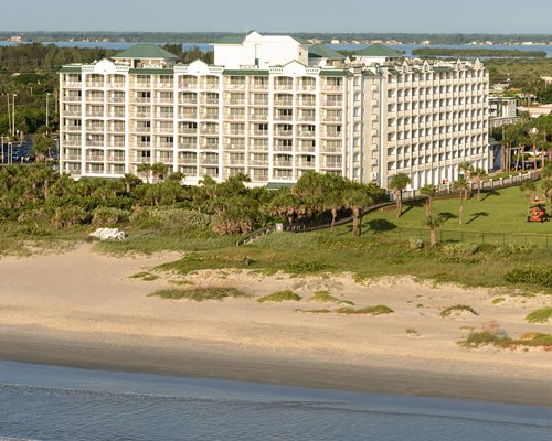 Scenic exterior view of The Resort on Cocoa Beach with multiple balconies alongside the beach.