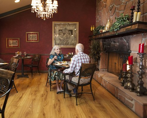 A couple in a fine dining restaurant at the Sedona Pines Resort.