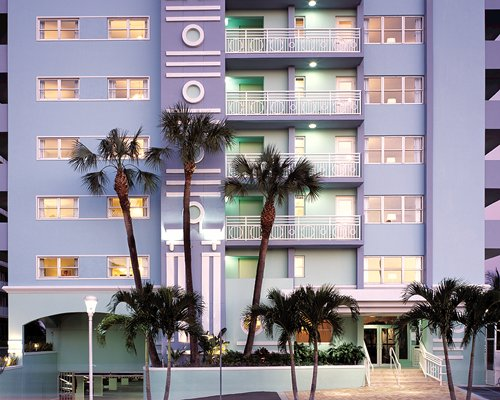 Exterior view of the Solara Surfside resort at night.