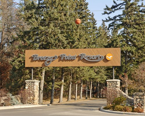 Signboard of Breezy Point Resort.