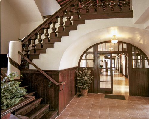 A well furnished indoor hallway with a staircase.