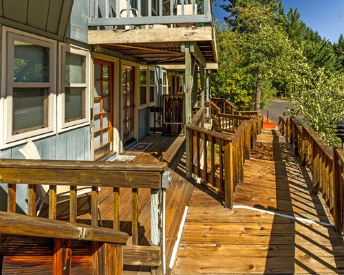 An exterior view of the Mountain Retreat resort unit with the wooden pathway.