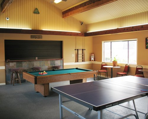 An indoor recreational area with pool table and ping pong.