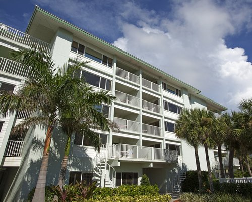A scenic ground view of the multi story unit with private balconies.