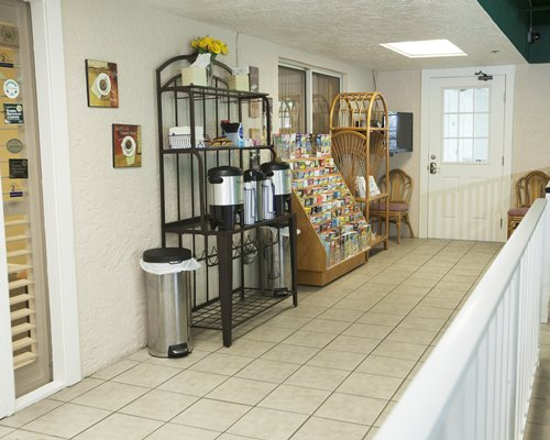 A view of the mini library with a vacuum flask at the resort.