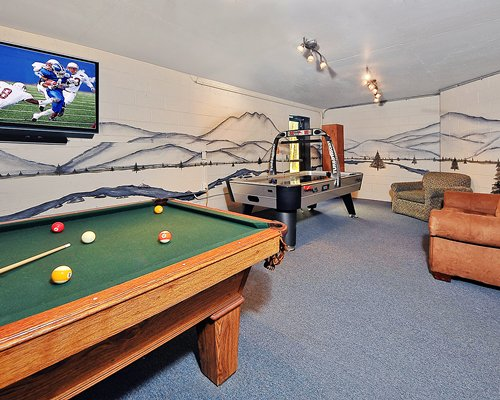 An indoor recreational pool table and air hockey.