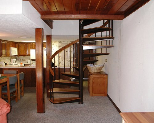 View of spiral stairs alongside the kitchen and dining area.