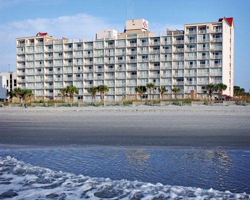 A beach view of multi story resort units.